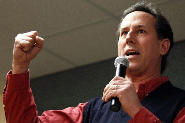 Rick Santorum pumps his fist at a rally wearing a sweater vest.