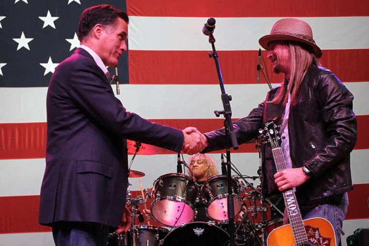 Mitt Romney greeting musician Kid Rock during a campaign rally in Royal Oak, Michigan on Monday.