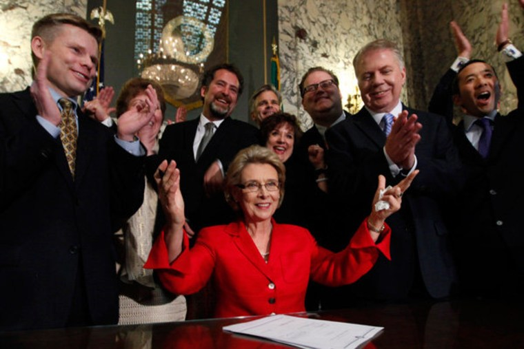 Gov. Christine Gregoire surrounded by supporters after signing a bill that legalizes same-sex marriage in Olympia, Washington on Monday.