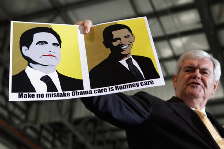 Newt Gingrich holding up a sign made by a supporter during a campaign rally at the Tampa Jet Center on Monday.