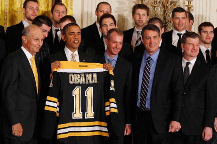 President Obama posing with the Boston Bruins at the White House on Monday.