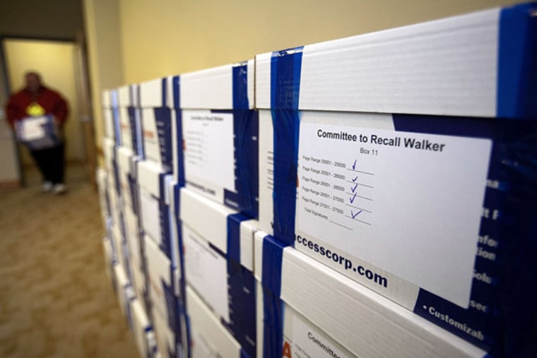 Boxes containing signatures to recall Gov. Scott Walker pile up in a store room at the Government Accountability Offices in Madison, Wisconsin on Tuesday.