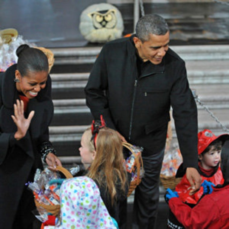 President Obama and first lady Michelle Obama greeting trick-or-treaters at the White House on Saturday.