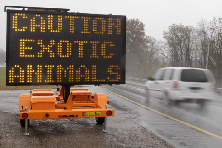 A sign warning motorists of exotic animals near Zanesville, Ohio Wednesday.