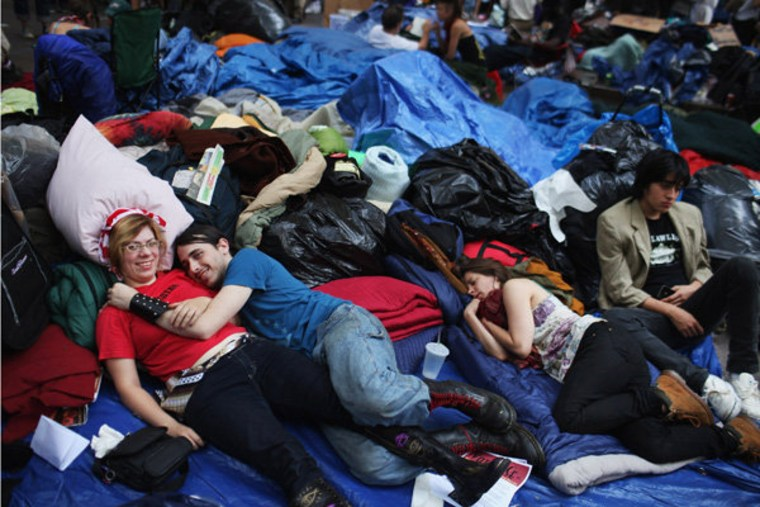 Occupy Wall Street protesters resting in New York City's Zuccotti Park on Monday.