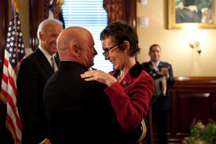 Captain Mark Kelly hugs his wife, Congresswoman Gabrielle Giffords after receiving the Legion of Merit from Vice President Joe Biden in Washington, D.C. on Thursday.