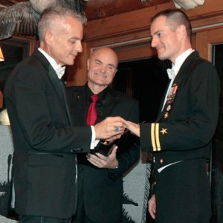 Navy Lt. Gary Ross and Dan Swezy exchange wedding vows in Duxbury, Vermont on Tuesday.
