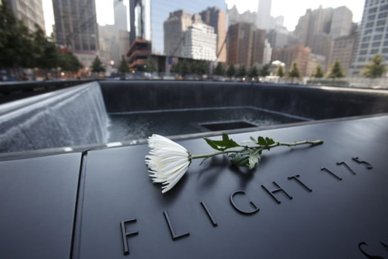 A flower sitting on one of the panels displaying names of victims at the 9/11 memorial in New York on Monday.