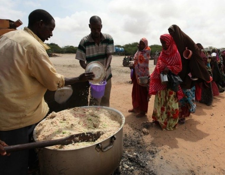 Displaced Somali people line up for food south of Mogadishu on Sept. 5, 2011