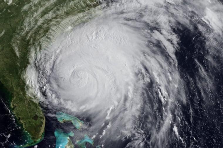 Satellite image of Hurricane Irene churning near the coastline on Friday.