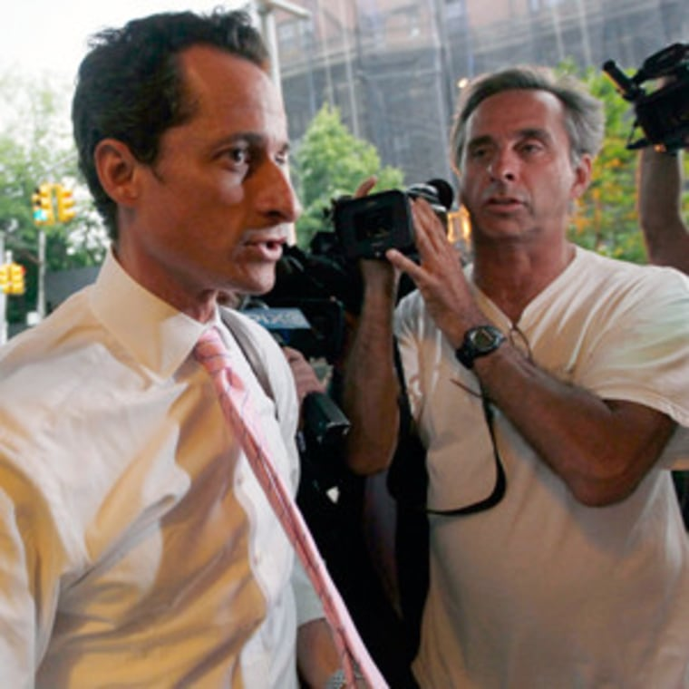 Rep. Anthony Weiner surrounded by reporters near his house in the Queens borough of New York on Thursday.