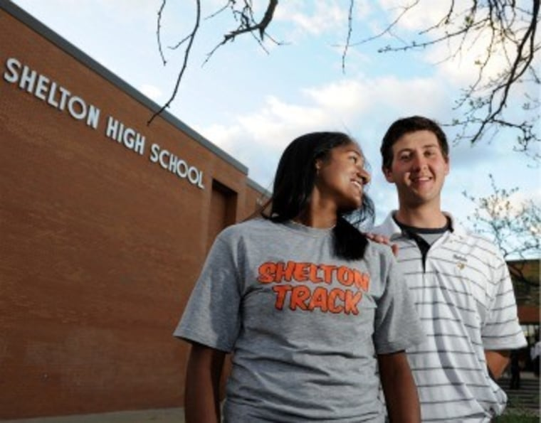 Suspended student James Tate and the girl he asked to prom in front of Shelton High School.