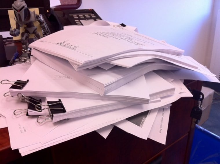 The ever-growing stack of papers on my desk (and yes BSG fans... that's a Cylon)