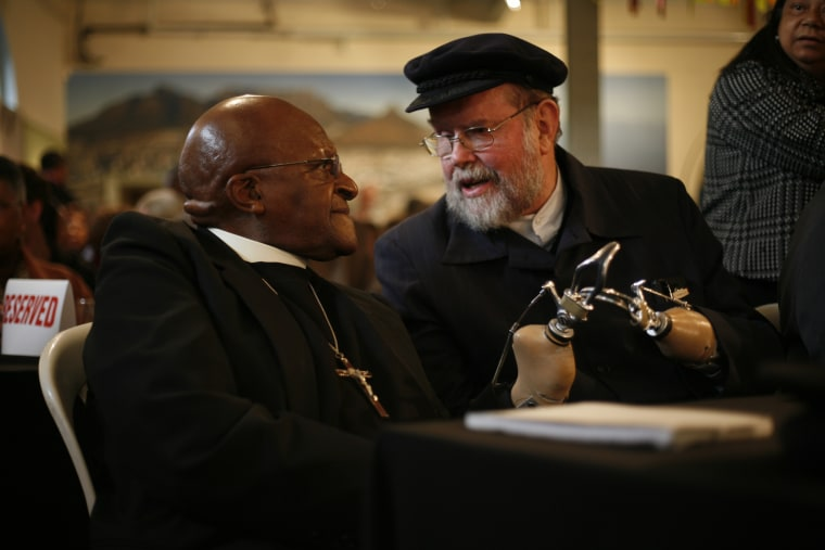 Father Michael Lapsley with Bishop Desmond Tutu (Ret.) last month in Cape Town, South Africa.
