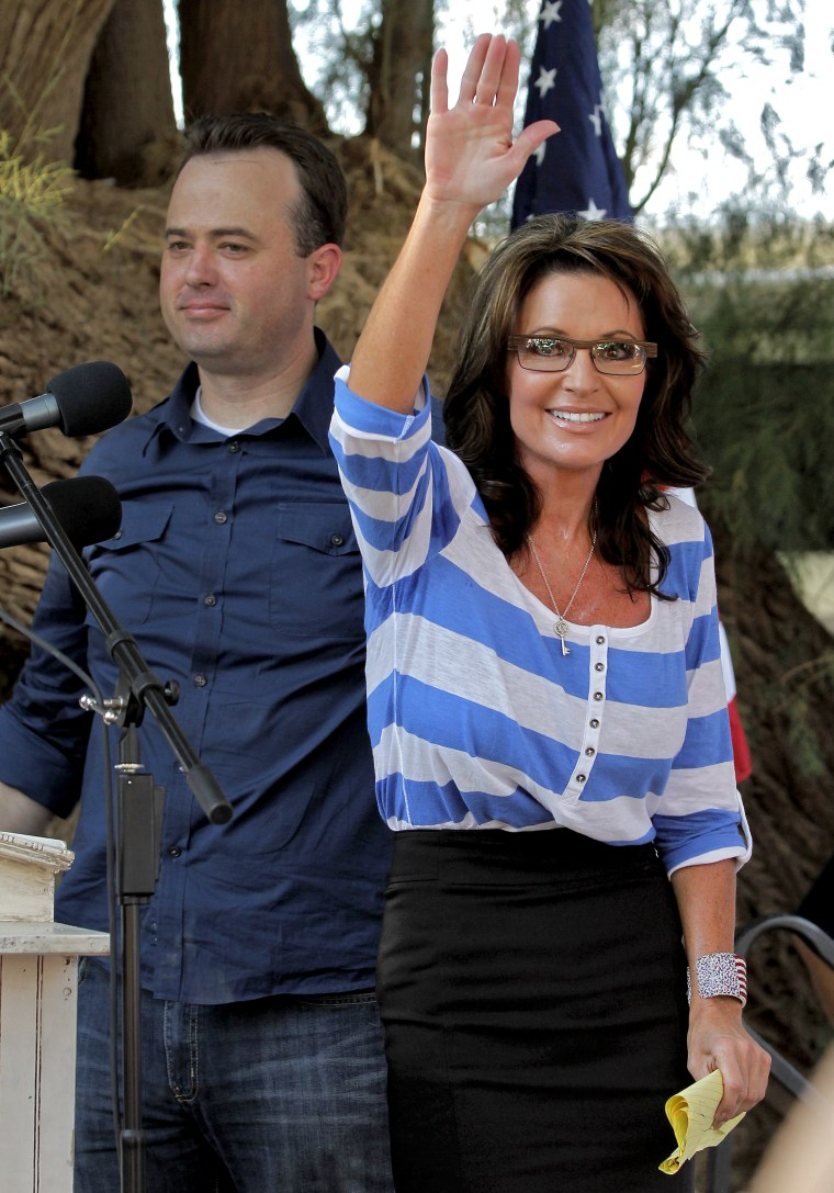 Former Alaska Gov. and Vice Presidential candidate Sarah Palin acknowledges the audience after speaking at a campaign rally for  Kirk Adams, left, a Republican candidate for U.S. Representative from Arizona's 5th Congressional District, Monday, Aug. 27...