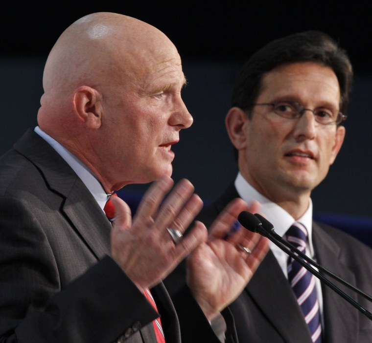 House majority leader Eric Cantor, R-Va., right, listens to Democratic challenger Wayne Powell during a Chamber of Commerce debate in Richmond, Va., Monday, Oct. 1, 2012.  (AP Photo/Steve Helber)