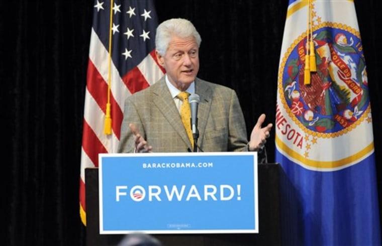 Former President Bill Clinton addresses a Students for Obama rally at the University of Minnesota's McNamara Alumni Center Tuesday, Oct. 30, 2012 in Minneapolis. (AP Photo/Jim Mone)