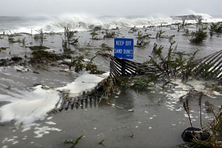 Rough surf of the Atlantic Ocean breaks over the dunes Monday morning, October 29, in Cape May, N.J., as high tide and Hurricane Sandy begin to arrive.(Photo: AP/ Mel Evans)