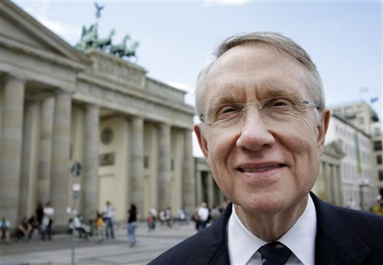 Senate Majority Leader Harry Reid poses for a picture in front of the Brandenburg Gate after a news conference at the U.S. Embassy in Berlin on Friday, Aug. 8, 2008. (AP Photo/Miguel Villagran)