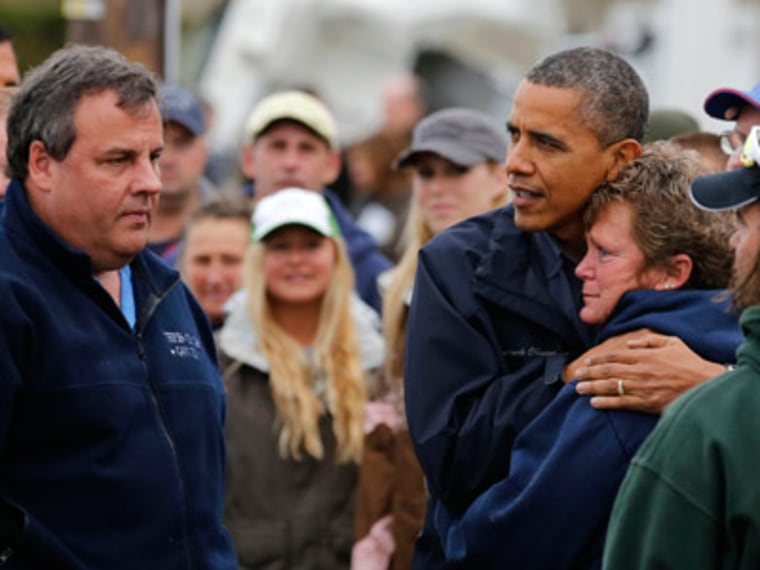 Gov. Chris Christie and President Obama meeting with locals Brigantine, New Jersey on Wednesday. (Larry Downing/Reuters)