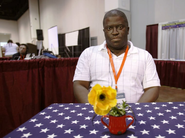 Alvin McEwen, of liberal democrat from Columbia, S.C., discusses politics with Julie Winokur, executive director of Talking Eyes Media, for her new project, Bring it to the Table, at the Netroots Nation 2012 Convention Thursday at the Rhode Island...