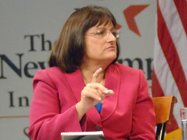 Democrat Ann McLane Kuster at one of her debates with Republican Congressman Charles Bass at the New Hampshire Institute of Politics & Political Library in Manchester, N.H. (Photo by AP Photo/The Union Leader, David Lane)