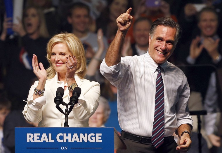 Mitt Romney and his wife, Ann, campaigned at a rally in Manchester, New Hampshire, November 5, 2012. (Photo by Jim Young/Reuters)