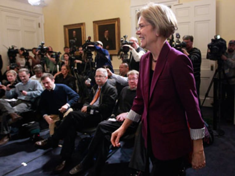 U.S. Sen.-elect Elizabeth Warren, D-Mass., walks past members of the media as she makes her way to the podium before a news conference at the Statehouse, in Boston, Thursday, Nov. 8, 2012. Warren met with Mass. Gov. Deval Patrick Thursday at the...