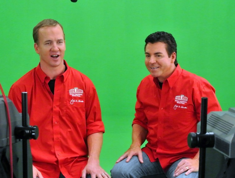 Papa John's founder and CEO, John Schnatter (r.), is scapegoating Obamacare for a contracted economy. (Photo by Jack Dempsey/Invision for Papa John's/AP Images)
