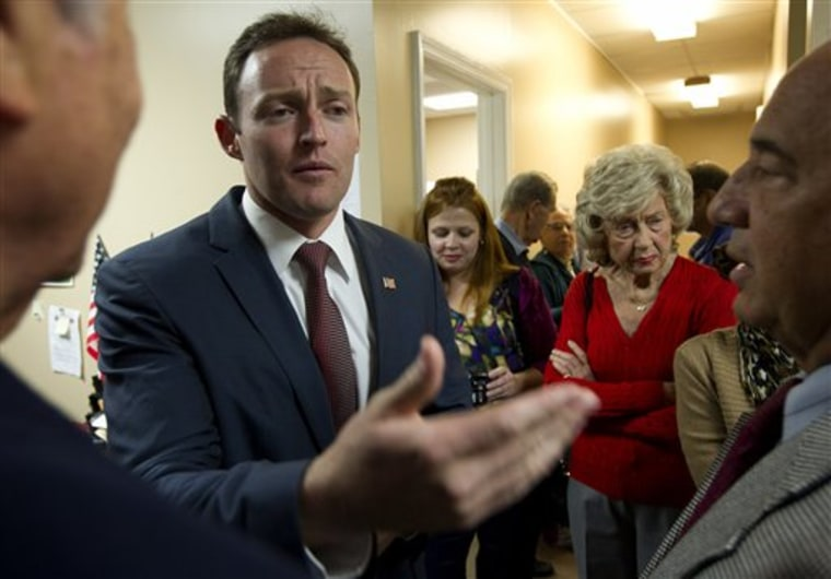 "Patrick Murphy, the Democratic candidate for Florida's 18th Congressional District, talks to supporters during a ""thank you"" tour of his district, Thursday, Nov. 8, 2012 in Palm Beach Gardens. (AP Photo/J Pat Carter)"