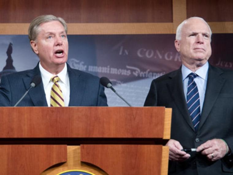 Senators John McCain and Lindsey Graham speaking at a press conference on Wednesday in Washington, D.C. (Karen Bleier/Getty Images)