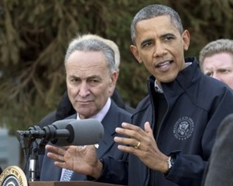 President Barack Obama gestures as he speaks during a news conference on Cedar Grove Avenue, a street significantly impacted by Superstorm Sandy, Thursday, Nov. 15,2012, on Staten Island, with New York Sen. Chuck Schumer. (AP Photo/Carolyn Kaster)