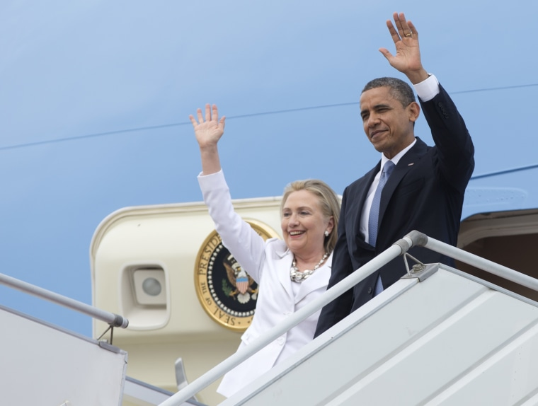U.S. President Barack Obama and Secretary of State Hillary Rodham Clinton wave as they arrive at Yangon International Airport in Yangon, Myanmar. (Photo by Carolyn Kaster/AP)