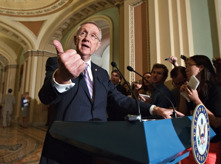 Senate Majority Leader Harry Reid of Nev. speaks to reporters on Capitol Hill in Washington, Tuesday, June 26, 2012, following the Democrats' weekly strategy session.  (AP Photo/J. Scott Applewhite)
