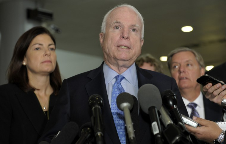 Sen. John McCain, R-Ariz., ranking Republican on the Senate Armed Services Committee, center, flanked by fellow committee members, Sen. Kelly Ayotte, R-N.H., left, and Sen. Lindsey Graham, R-S.C., right, speaks  on Capitol Hill in Washington, Tuesday,...