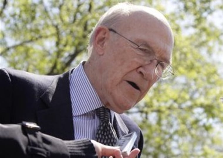 This April 14, 2011 file photo shows Alan Simpson, then- co-chairmen of the president's deficit reduction commission, talking to reporters outside the White House in Washington. (AP Photo/Carolyn Kaster, File)