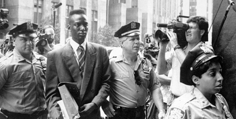 """This film image released by Sundance Selects shows accused rapist Yusef Salaam being escorted by  police in New York in 1990. Salaam is the subject of the documentary, \""""The Central Park Five\"""" (Photo: AP Photo/Sundance Selects, NY Daily News)"""