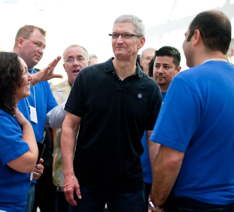 In this handout image provided by Apple, Apple store employees greet CEO Tim Cook at the new Apple Store on October 27, 2012 in Palo Alto, California. (Photo by Don Feria/Apple via Getty Images)