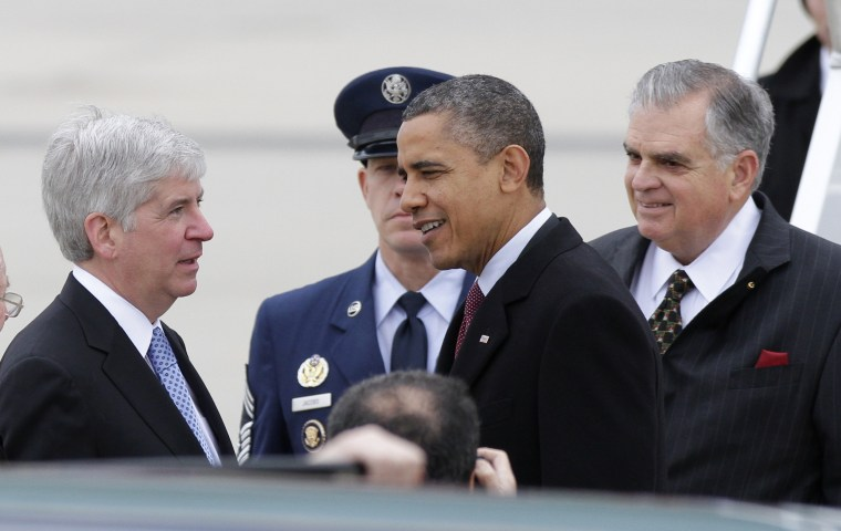 President Barack Obama was greeted by Michigan Gov. Rick Snyder hours before he criticized right-to-work legislation Snyder has helped push through the State House in the last week (Photo by Duane Burleson/AP)