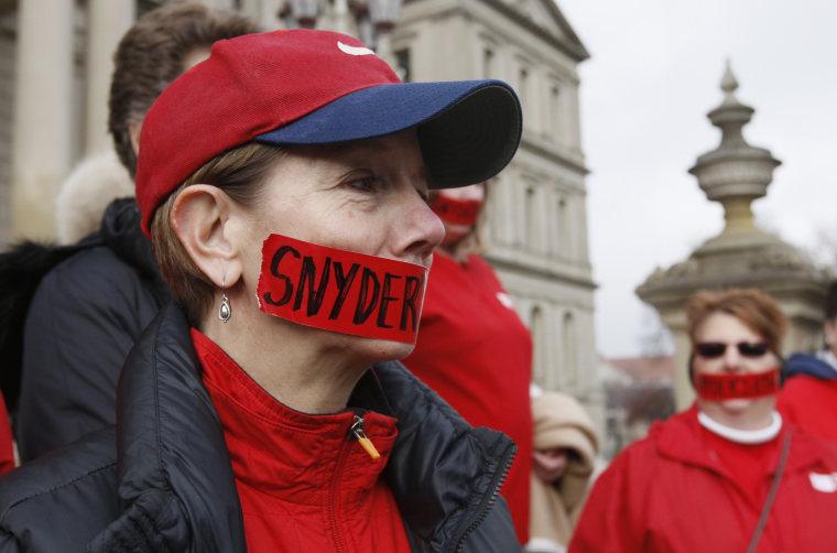 "Linda Erspamer, a nurse, protests Michigan's new \""right-to-work\"" legislation on December 10. (AP Photo/Carlos Osorio)"