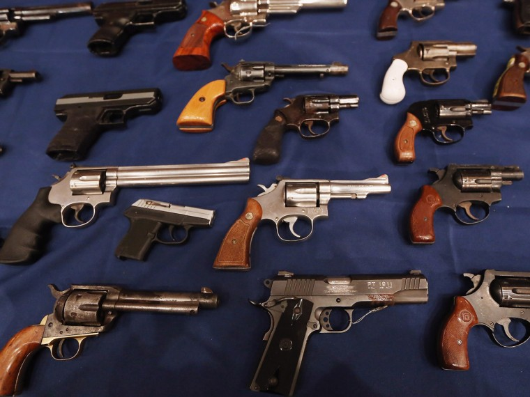 A table of illegal firearms confiscated in a large weapons bust in East Harlem are on display at a press conference on October 12, 2012 in New York City.  (Mario Tama / Getty Images)