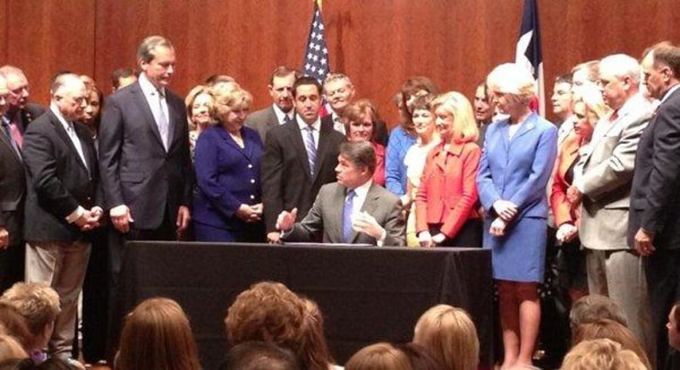 Texas' Perry signs new restrictions on reproductive rights