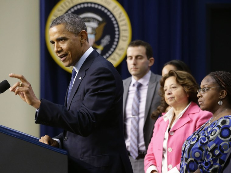 On the final day before the U.S. was to go over the so-called fiscal cliff, President Barack Obama addressed the nation, flanked by 14 middle class Americans, for his pitch ostensibly on their behalf on tax rate negotiations. (AP Photo/Charles Dharapak)