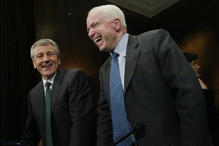 Chuck Hagel, center, R-Neb, and John McCain, right, R-Ariz, share a laugh on the Capitol Hill, Thursday, Feb. 12, 2004 in Washington.   (Photo by Manuel Balce Ceneta/AP)