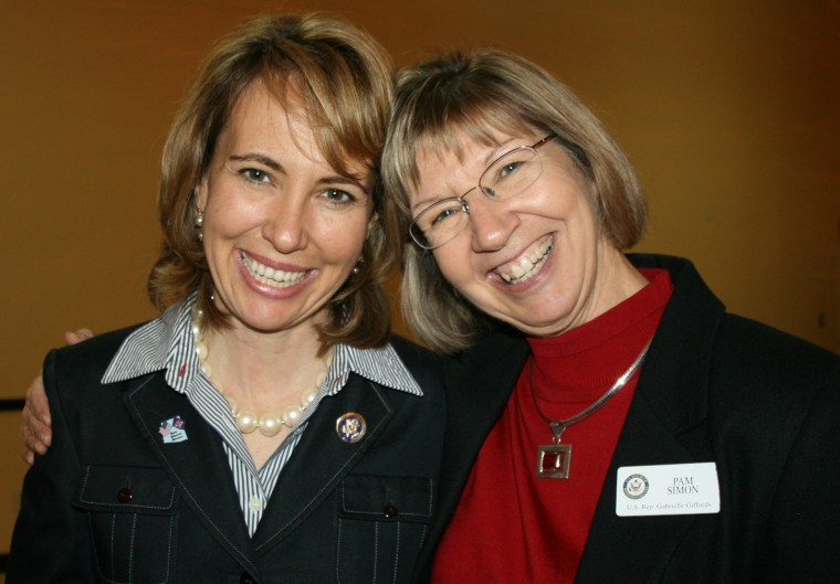 This undated photo released by the Office of U.S. Rep. Gabrielle Giffords, D-Ariz, shows Giffords, left, posing for a photo with Pam Simon, who works in community outreach in Rep. Gabrielle Giffords' office. Simon was wounded in the Saturday Jan. 8,...