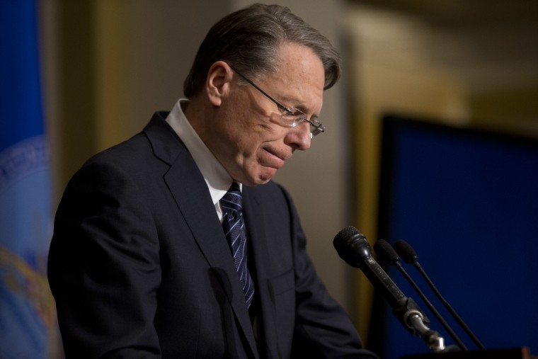 File Photo: National Rifle Association executive vice president Wayne LaPierre pauses as he makes a statement during a news conference in response to the Connecticut school shooting, on Friday, Dec. 21, 2012 (Photo by Evan Vucci/AP)