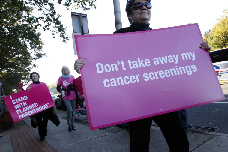 Planned Parenthood supporters demonstrate outside of Hofstra University the site of the presidential debate, Tuesday, Oct. 16, 2012, Hempstead, N.Y. President Obama and Republican presidential candidate, former Massachusetts Gov. Mitt Romney will hold...