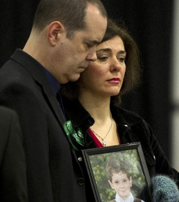 The parents of Benjamin Wheeler, a victim of the Sandy Hook Elementary School shooting, attend a news conference on January 14, 2013 in Newtown, Connecticut. Families of victims asked that there be a dialogue to find solutions on how to prevent similar...