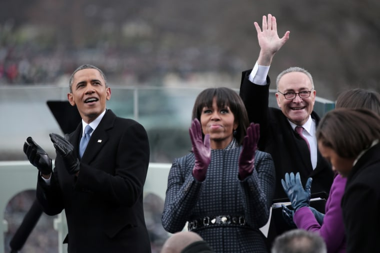 President Barack Obama, First Lady Michelle Obama and Sen. Charles Schumer (D-NY) clap during the presidential inauguration on January 21, 2013 in Washington, DC. (Photo by Ewin McNamee/AFP/Getty Images)
