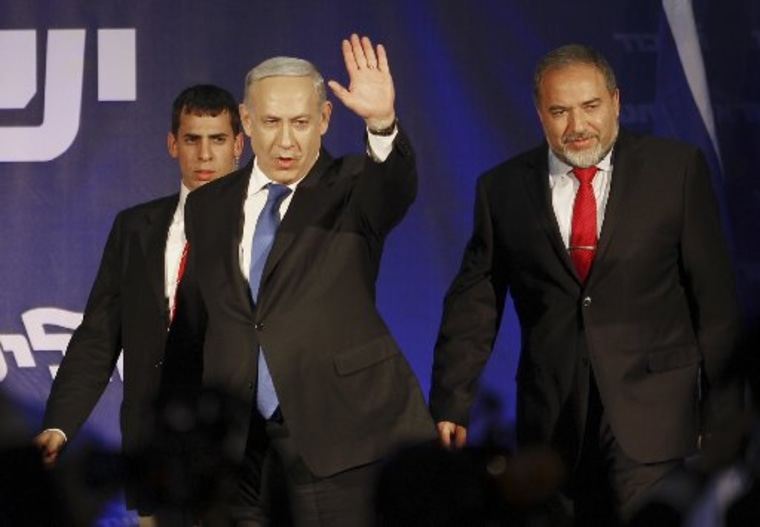 Israel's Prime Minister Benjamin Netanyahu and former Foreign Minister Avigdor Lieberman greet their supporters in Tel Aviv, Israel, Wednesday, Jan. 23, 2013. According to exit polls, Netanyahu's Likud Party emerged as the largest faction in a hotly...